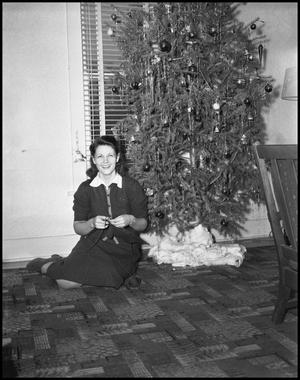 This smiling Dentonite is one of a cadre of women who knitted gifts for soldiers during the war, ca. 1942. Photo from texashistory.unt.edu.