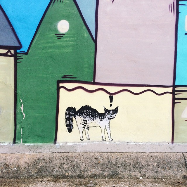 Cat graffiti on a mural.