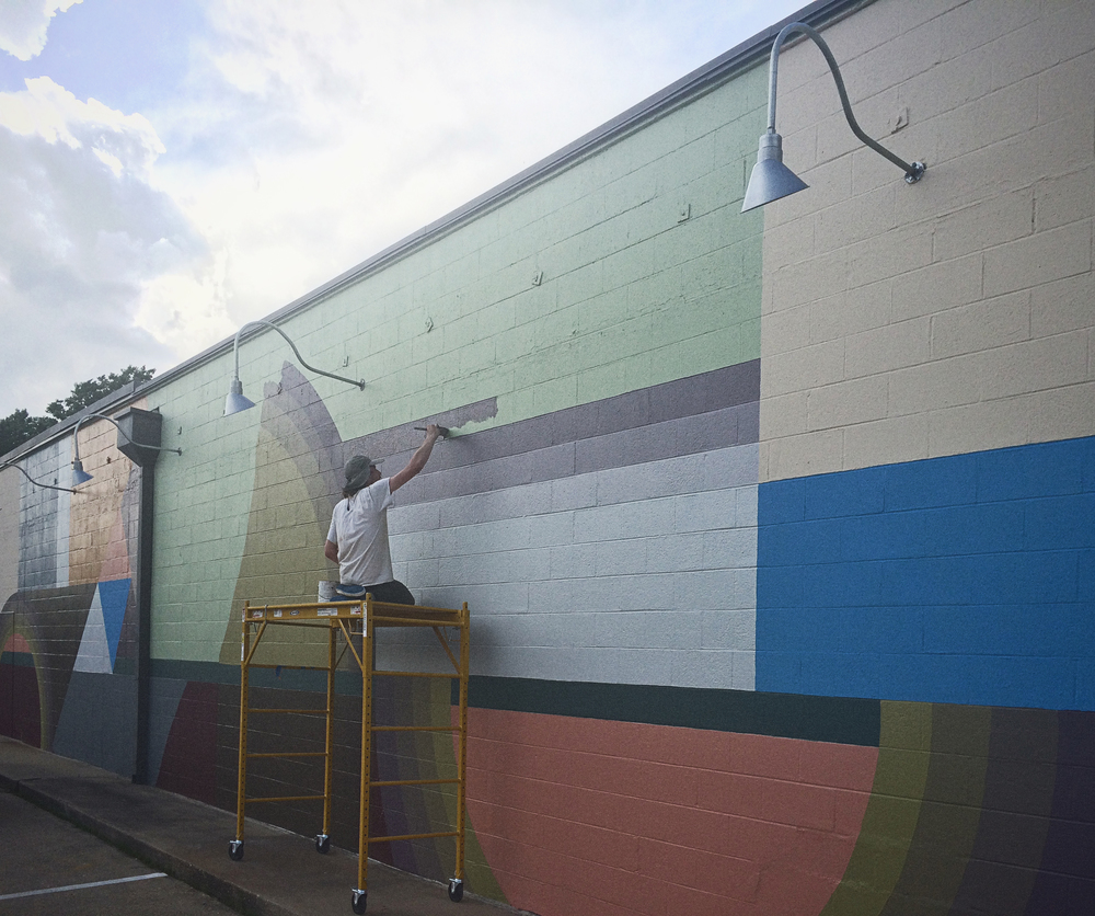 The man who paints Denton, Mick Burson, is hard at work at SCRAP with his newest mural. More info on that soon.