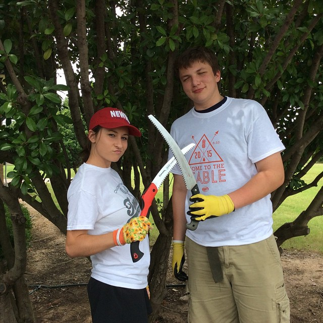 The student life service project working hard withKeep Denton Beautiful.