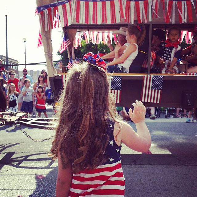Notice the face of the young girl on the float that is about to throw candy to the girl waving. Concentration, y'all.