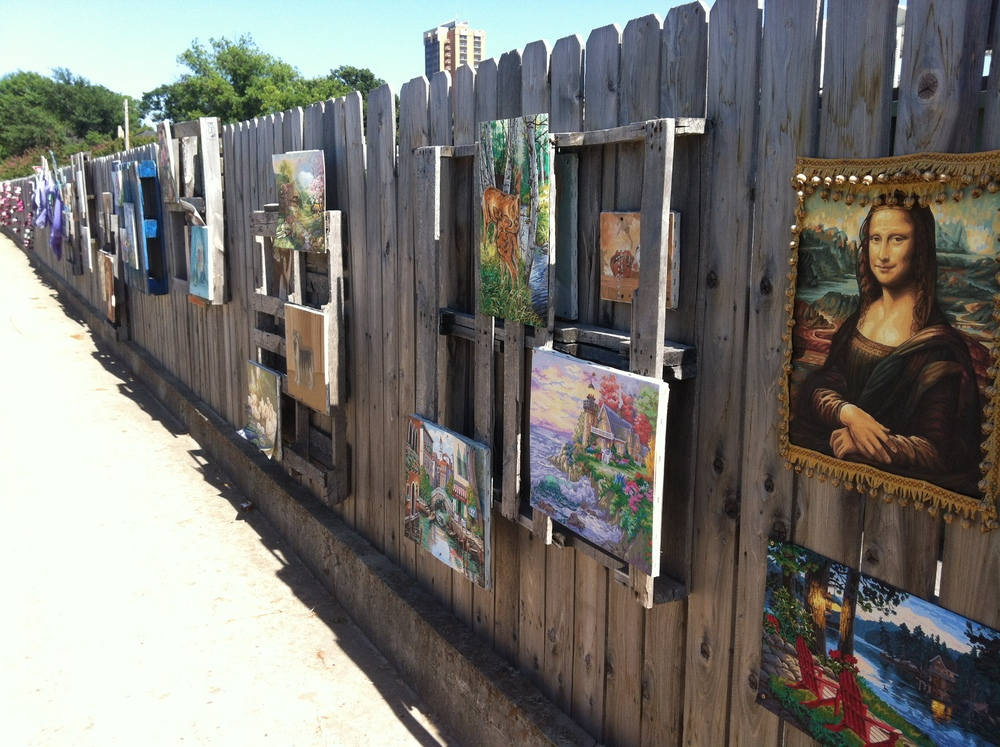 "Judy Smith's Art Fence, an ""adopt-a-spot"" icon for 20 years that proves ya best not mess with our local art! Photo from @Dentonaut."