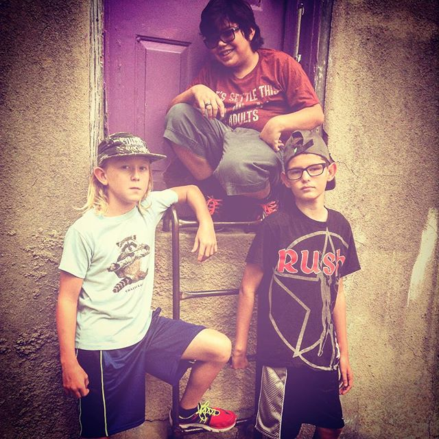 @owennichelson and his bandmates looking tough in front ofour favorite purple door.