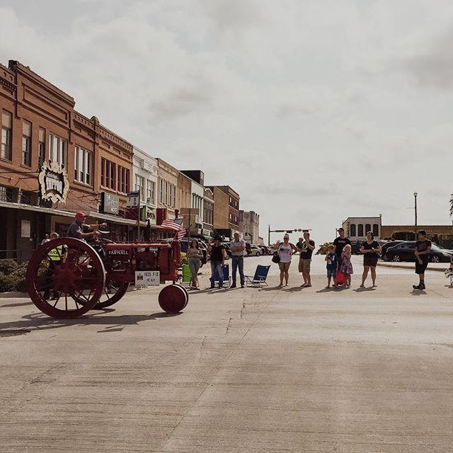 @nikareally captured the opening of the North Texas State Fair with this shot of a tractor rolling down Elm St. for the parade.