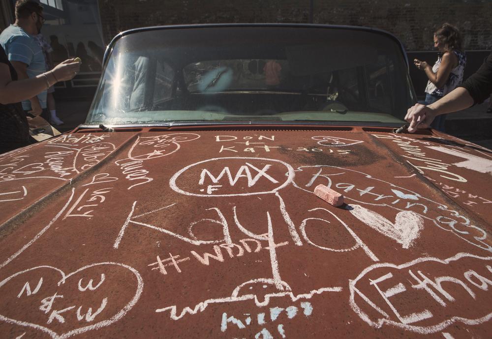 The chalk car at Arts, Antiques and Autos is always one of our favorites.