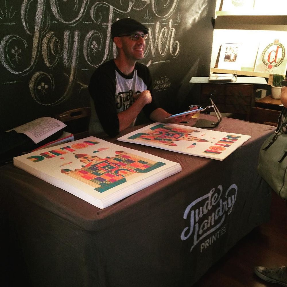 Jude Landry at The Dime Store's First Friday event with his new Courthouse poster.