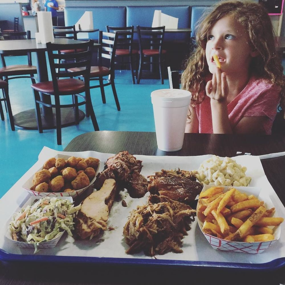 @KDaskam's wee one enjoying a nice platter of 'que at Bet the House.