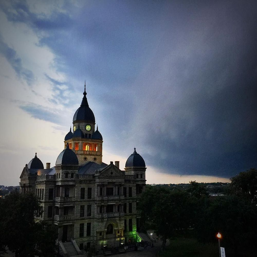 Dark clouds moving in over the Courthouse last Thursday evening. photo by @GlenFarris.