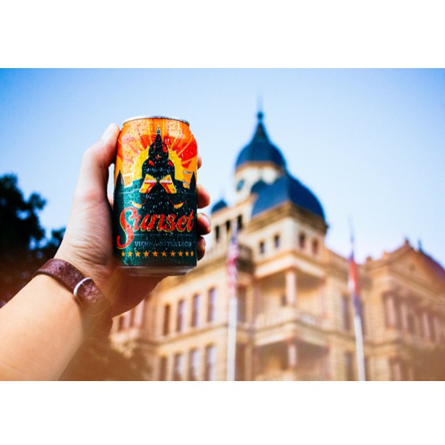 A great Denton beer in front of our courthouse. Photo by @filmhauspictures.