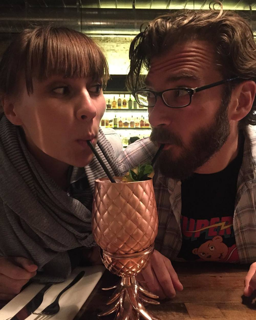 And we'll end with this overly-cute photo from @kimimcclellan of a couple sharing a drink at 940's.