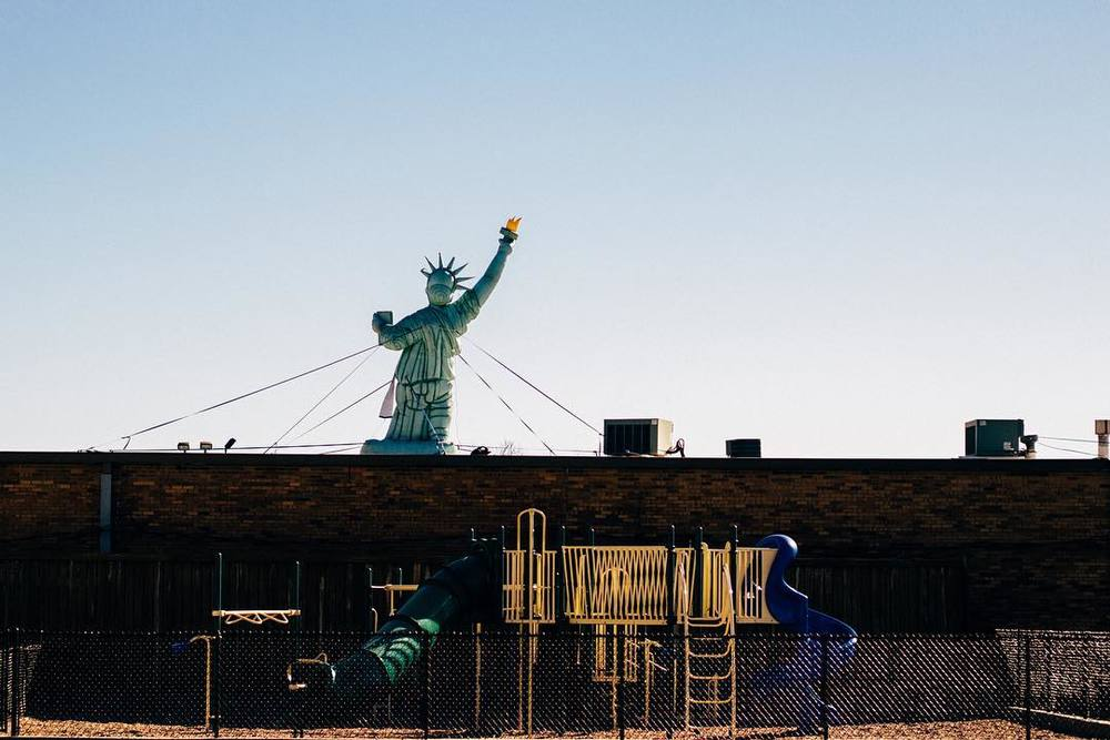 We'll end this week with a wonderful image from @andrewbwelch of a playground with a tax-day-friendly inflatable Lady Liberty in the background.