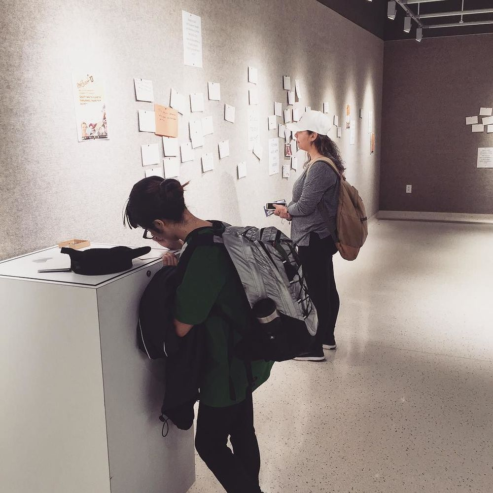 "Some students checking out the ""secret wall"" at @untuniongallery."