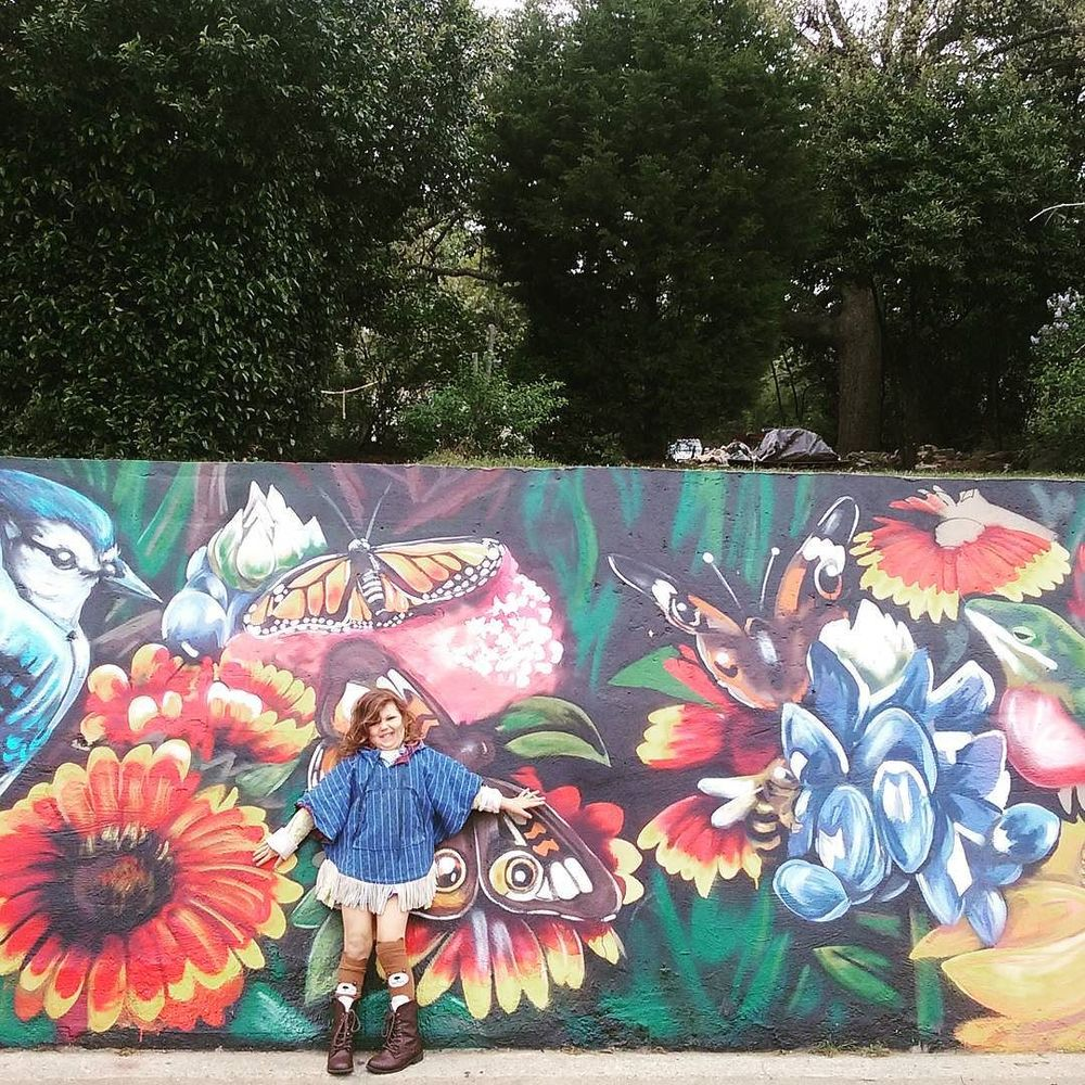 @thelovelybirds with a great shot in front of one of Keep Denton Beautiful's new murals in town.