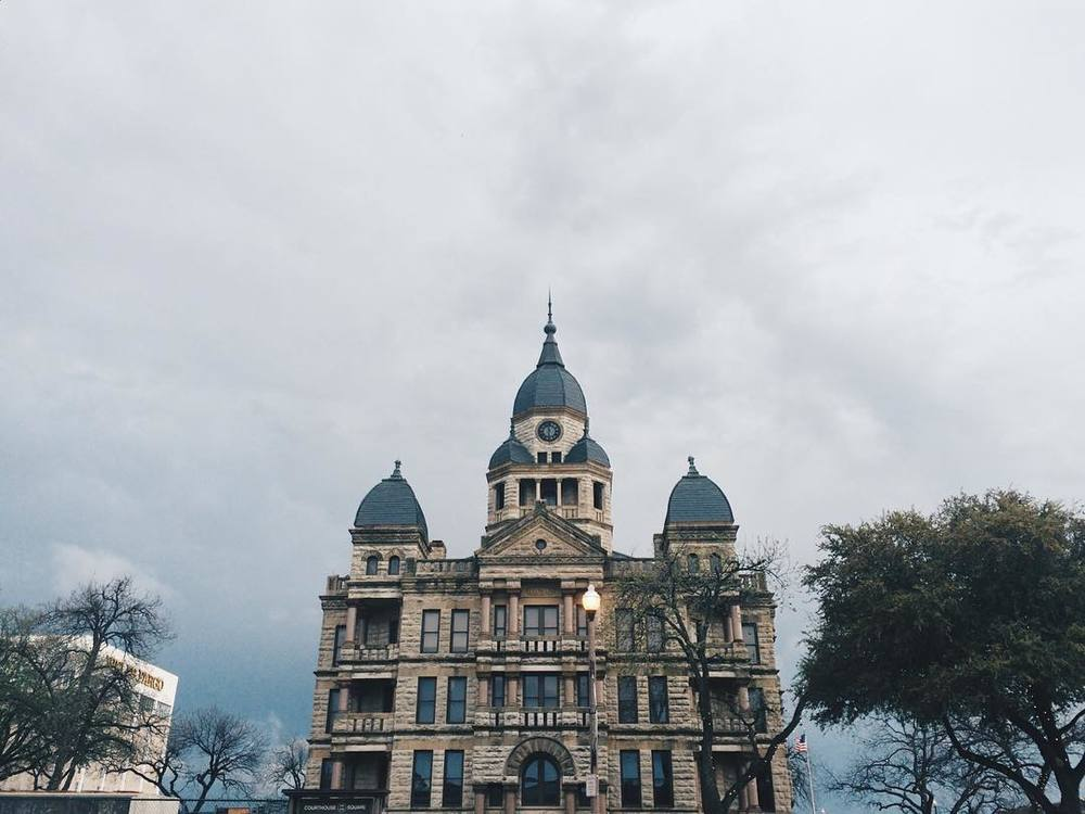 We'll end this week's post with this image of the courthouse in front of a cloudy sky from @jadewintersee.