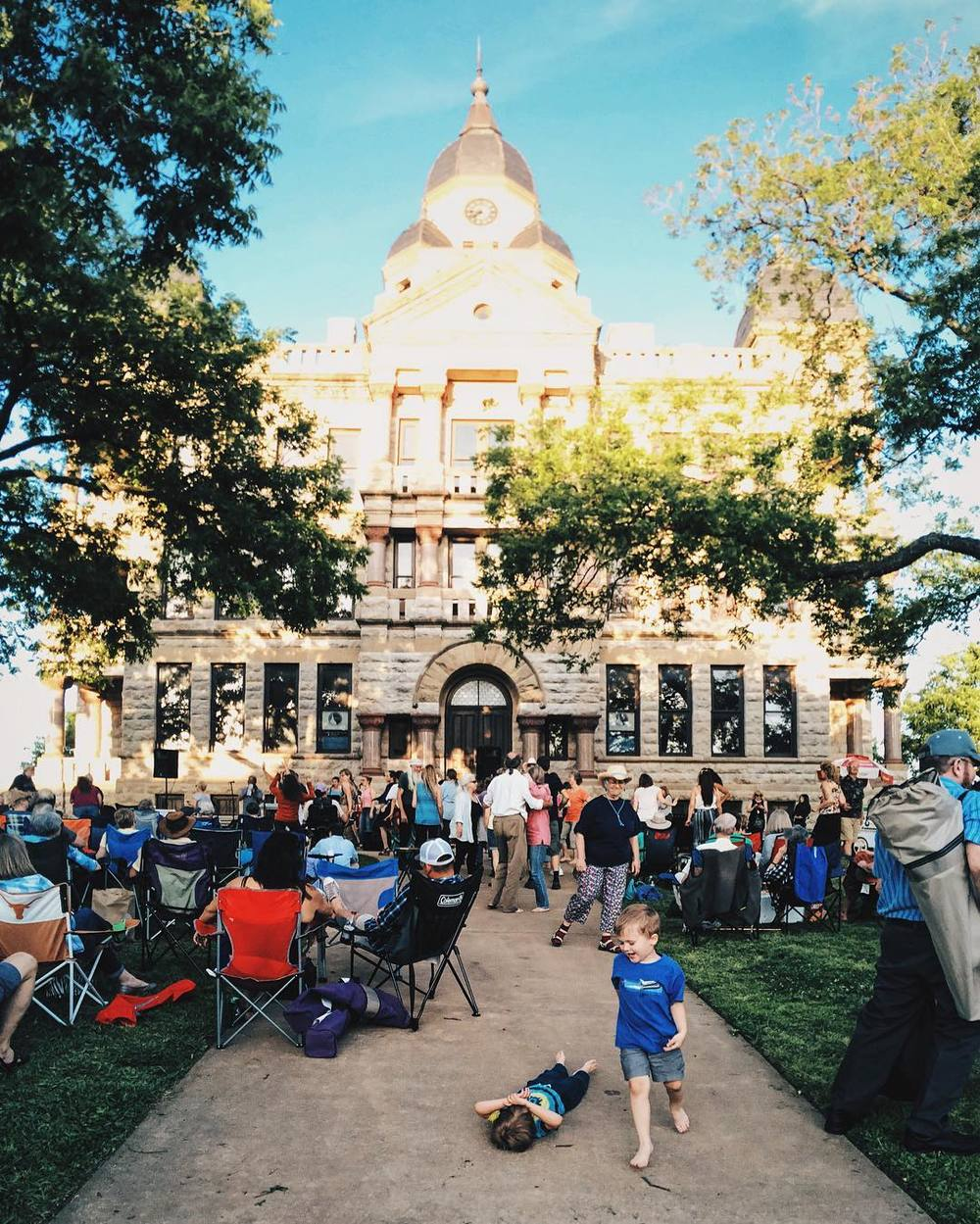 "Twilight Tunes is one of our favorite Denton springtime activities. Here's a photo from last week's festivities by @wedentondoit. Too bad Nick Amendola isn't allowed on the courthouse lawn anymore after the ""incident."""