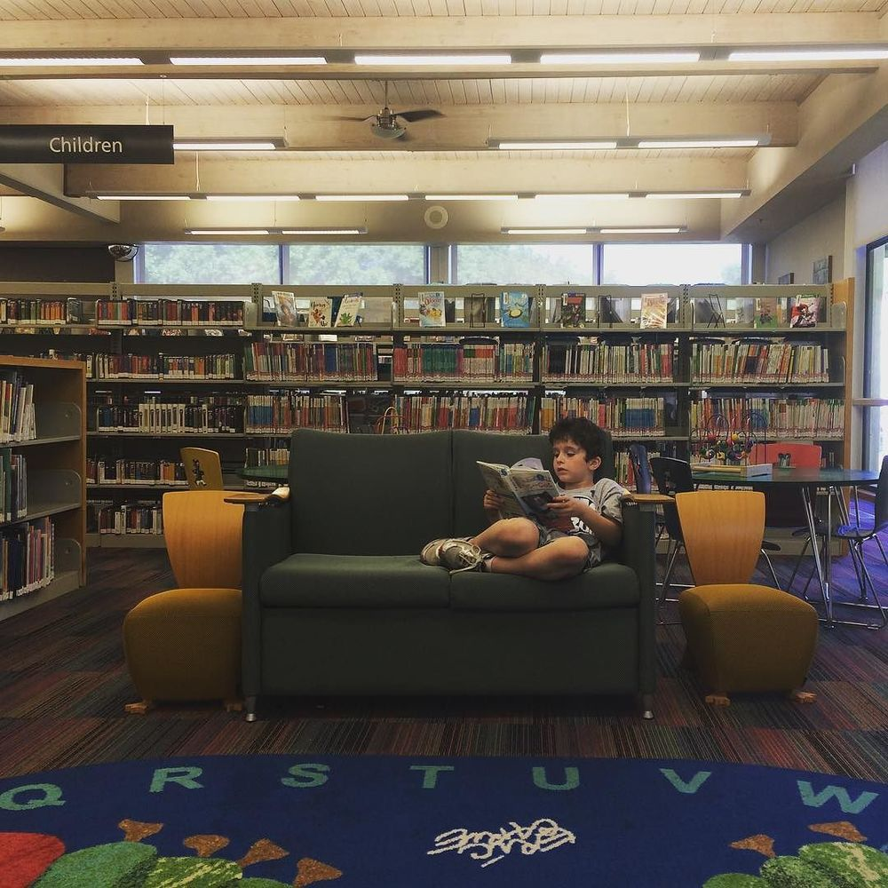 @kellyrien and some library lounging in the kid's section.