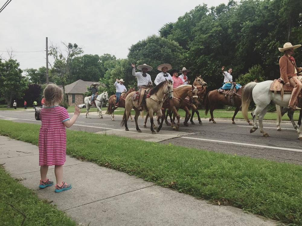 The slightly delayed Cinco de Mayo parade came through town with horses, mini frisbees, and candy galore. Photo by @archerplushare.