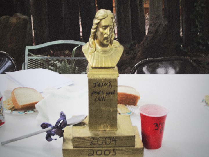 The original undefiled Golden Jesus Chili trophy, before it was sullied by upstart artistic embellishment, reflects the hand-scrawled back-yard origins of Denton's premiere chili brawl.