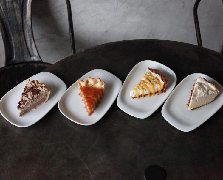 @westoakcoffee's new seasonal pie selection includes black and white pie, salted honey buttermilk pie, peaches and cream pie and lemon custard pie.