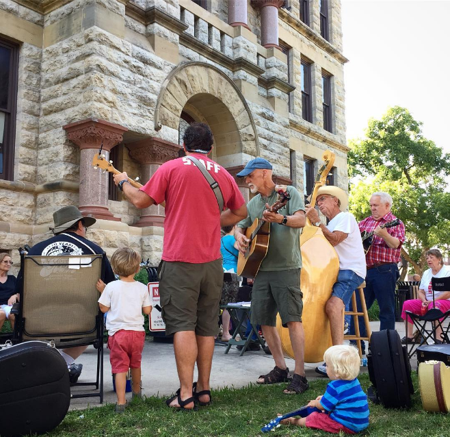 Saturday mornings mean bluegrass on the courthouse lawn. Some players are younger than others. Photo by @wildflowerartstudio.