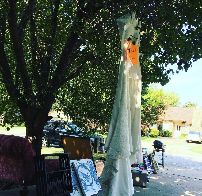 A used wedding dress at a garage sale. Photo from @elk.daisy.