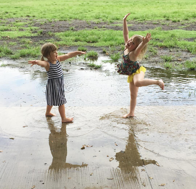 Playing in the rain last week. Photo by @mamastryin.