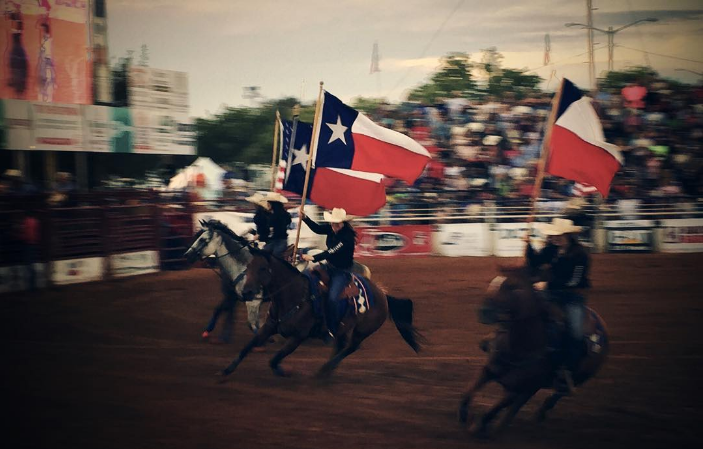 @venturingvesperado with a great shot of the presenting of the flags at the rodeo during the North Texas State Fair.