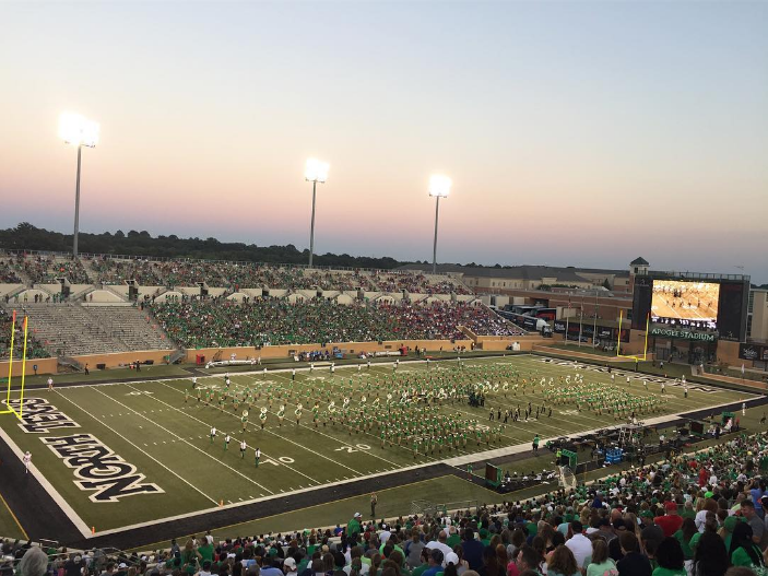 The UNT band on the field at Apogee at Saturday's game. Photo by @zooagarc.