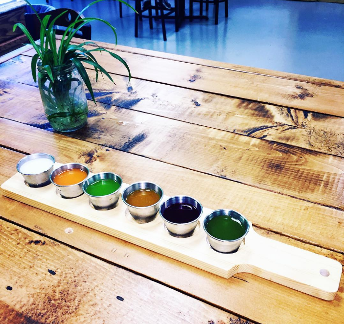 @juicelabdentontx now has juice flights with samples of cold pressed juices, flavored nut milks, cold brew coffee, kombucha, wellness shots, and lemonades.