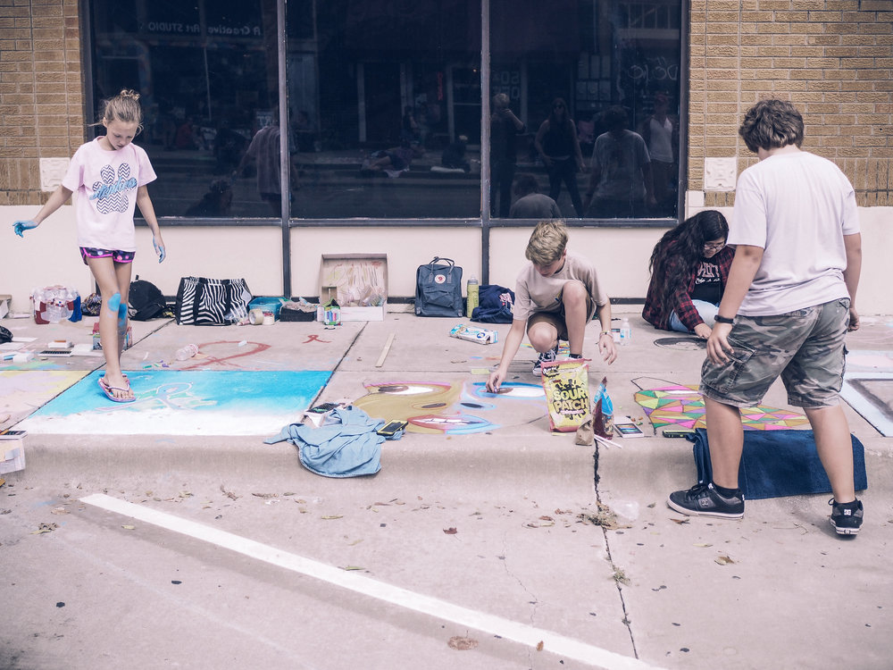 Participants in the sidewalk chalk art contest.