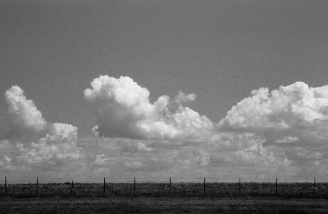 We'll end this week with this shot of clouds and barbed wire (on film) from @aaronlancelopez.