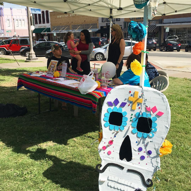 @dentondodfest and their sugar skull setup at the Hispanic Heritage festival on the square on Saturday.