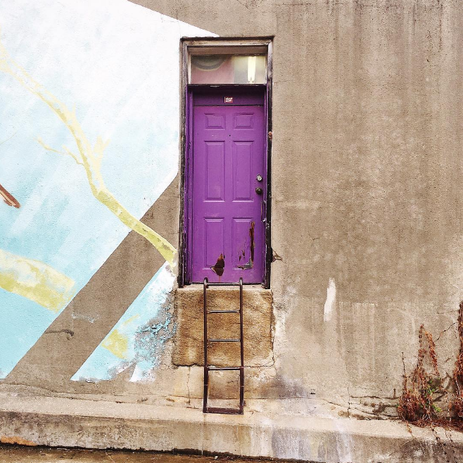 @caseykleeb at the purple door with a new mural from Dan Black.