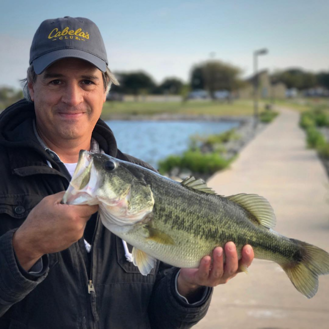 @glenfarris took this photo of Dave Sims holding a fish. I'm posting it in spite of Glen because it is a beautiful fish and I really like Dave.