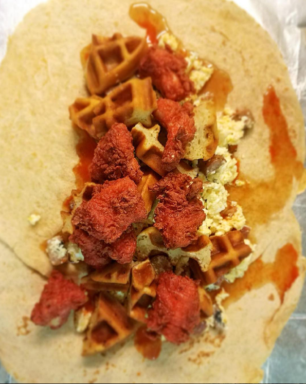 "This is the ""Kitchen Sink"" burrito from @Breckies' new late night menu. It consists of ""red velvet"" chicken, waffle bits, blueberry sausage, eggs, maple syrup, and Cholula hot sauce.  We aren't really sure how to feel about this."