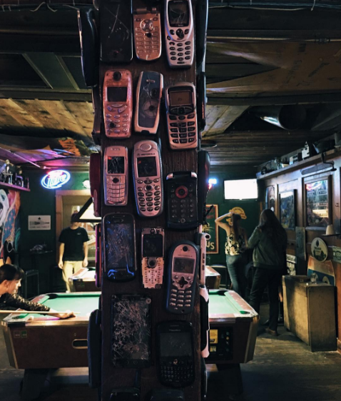 @justinpeacedfw with a photo of the phone wall at Riprock's.