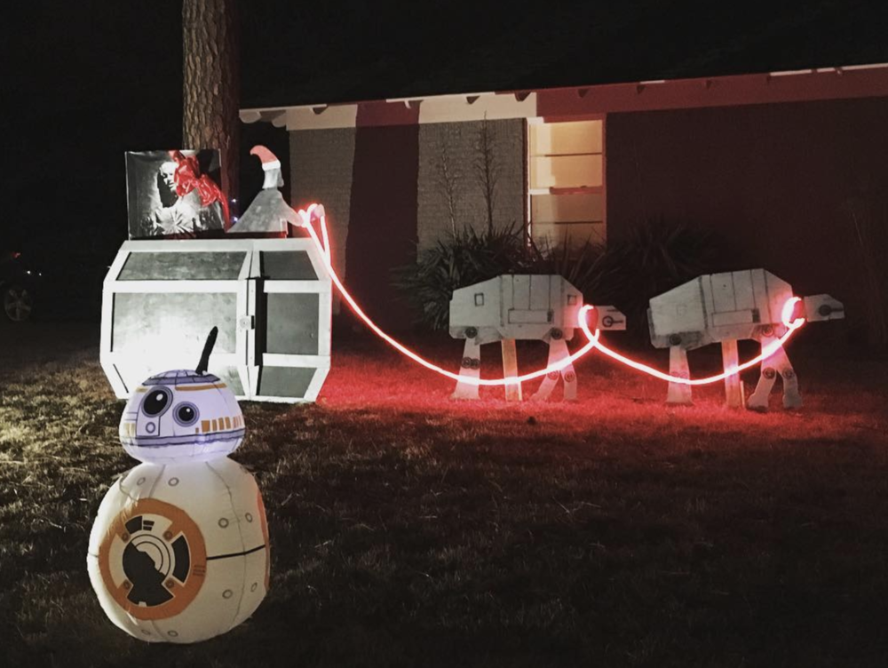 Santa Vader with Han Solo in carbonite and reindeer AT-AT's make this one of our favorite holiday lighting scenes in Denton this year. Photo by @dentonaut.