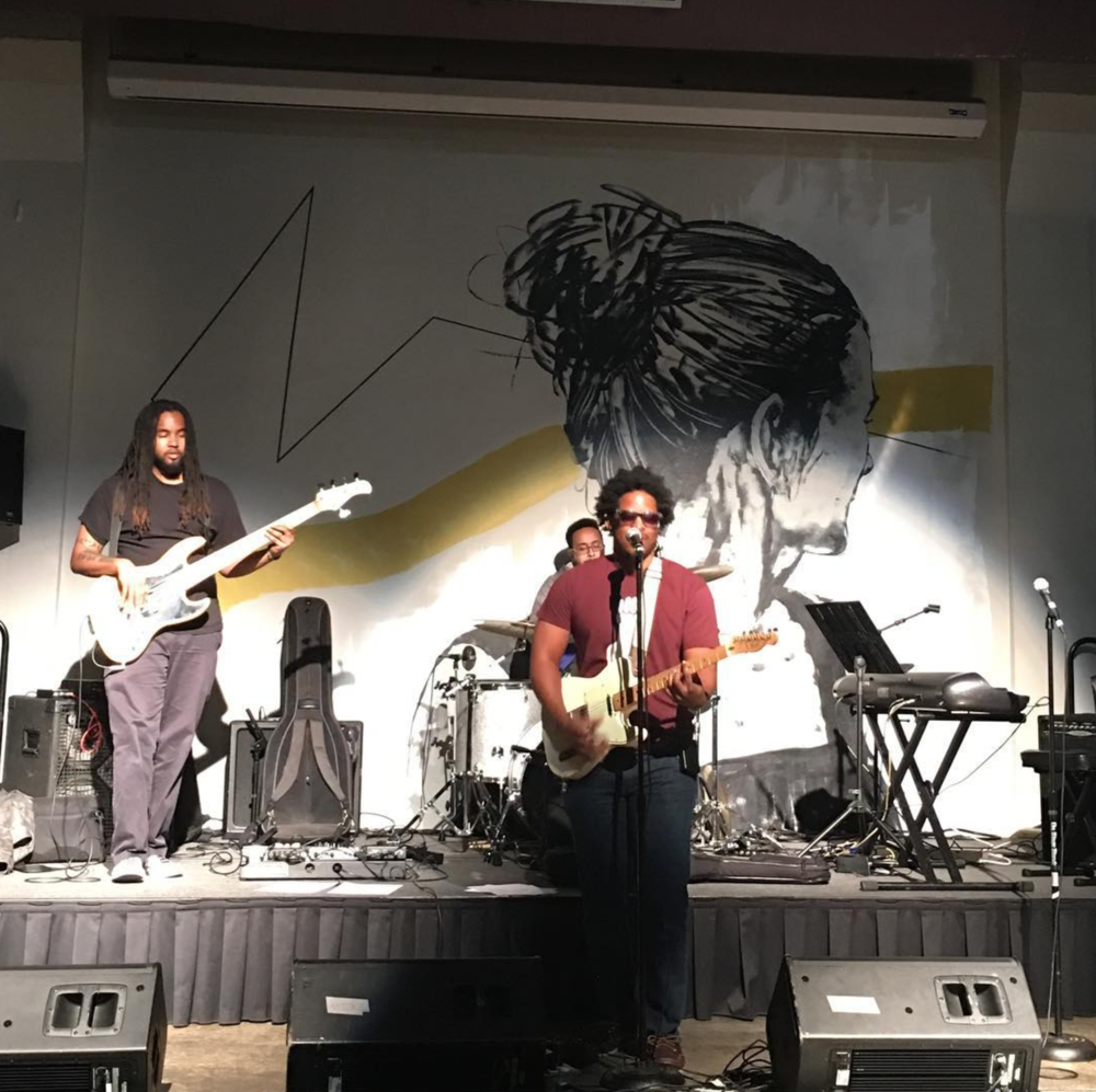 Quentin Moore jamming at the Denton Black Film Festival. Photo by @vee2daelle.