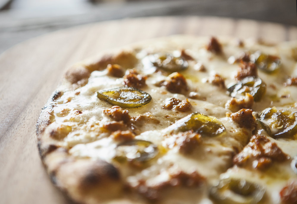 Candied jalapenos and sausage are two of the toppings on our favorite pizza at Pizza Snob.