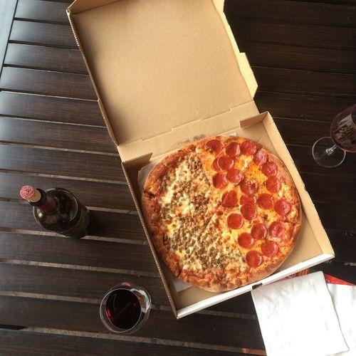 Jonuzi's Pizza and a bottle of wine.