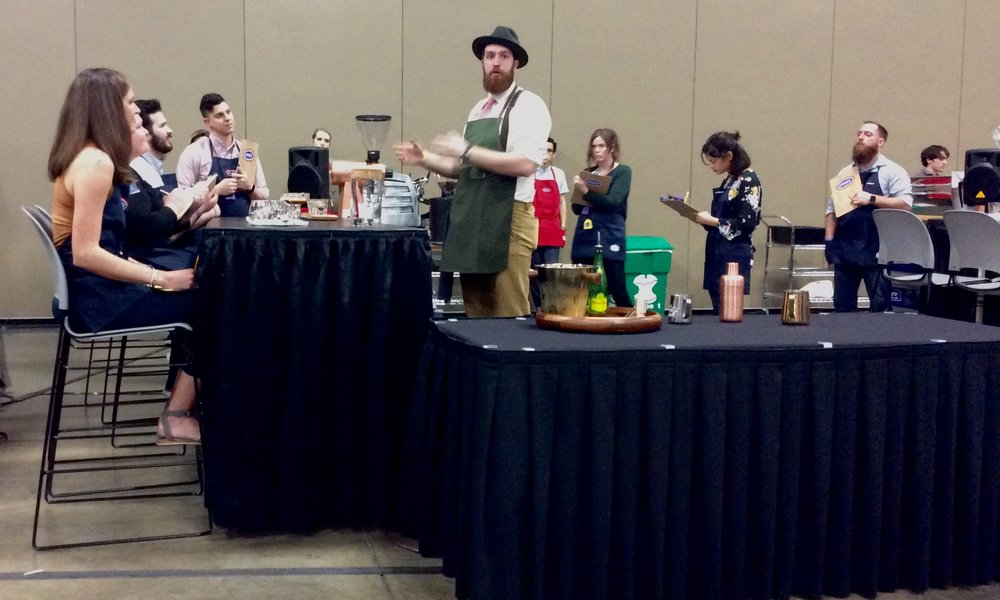 Josh Smith competes in the Barista Competition. He made a beautiful presentation. @thepaulbunyan