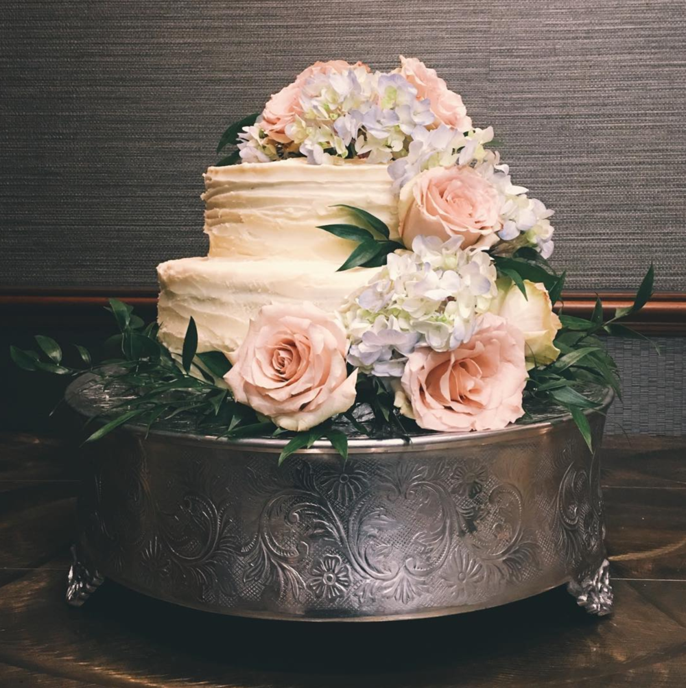An impressive wedding cake from Denton's @scoutbakedgoods.