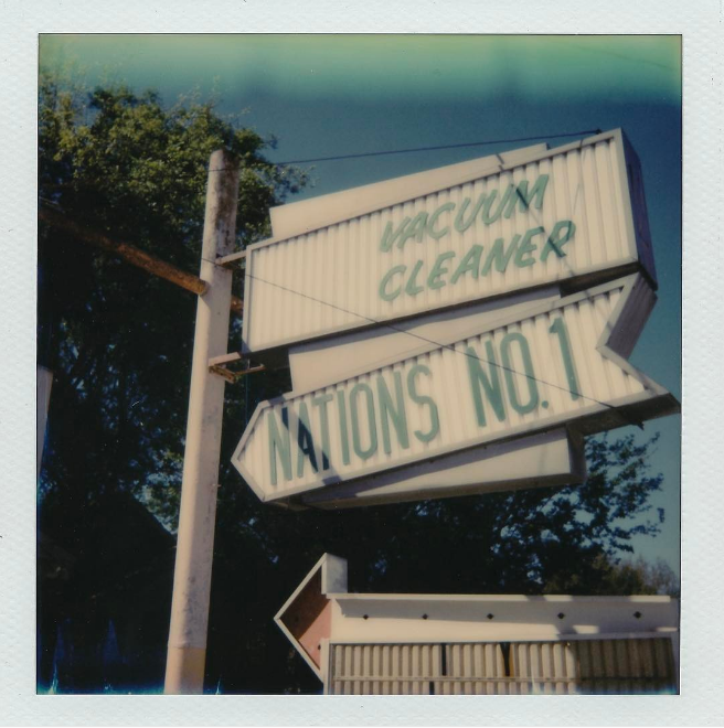 @andy07 and his trusty Polaroid shot this photo of some of Denton's oldest signage.