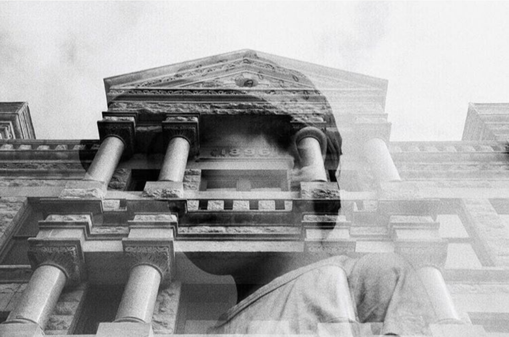 @aaronlancelopez with a very cool double exposure shot of a wee one and the front of the Denton County Courthouse.