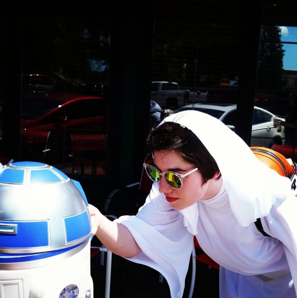 Leia in shades recording onto R2 on the Denton square during Star Wars Day last week. Photo by @actualkaijukate.