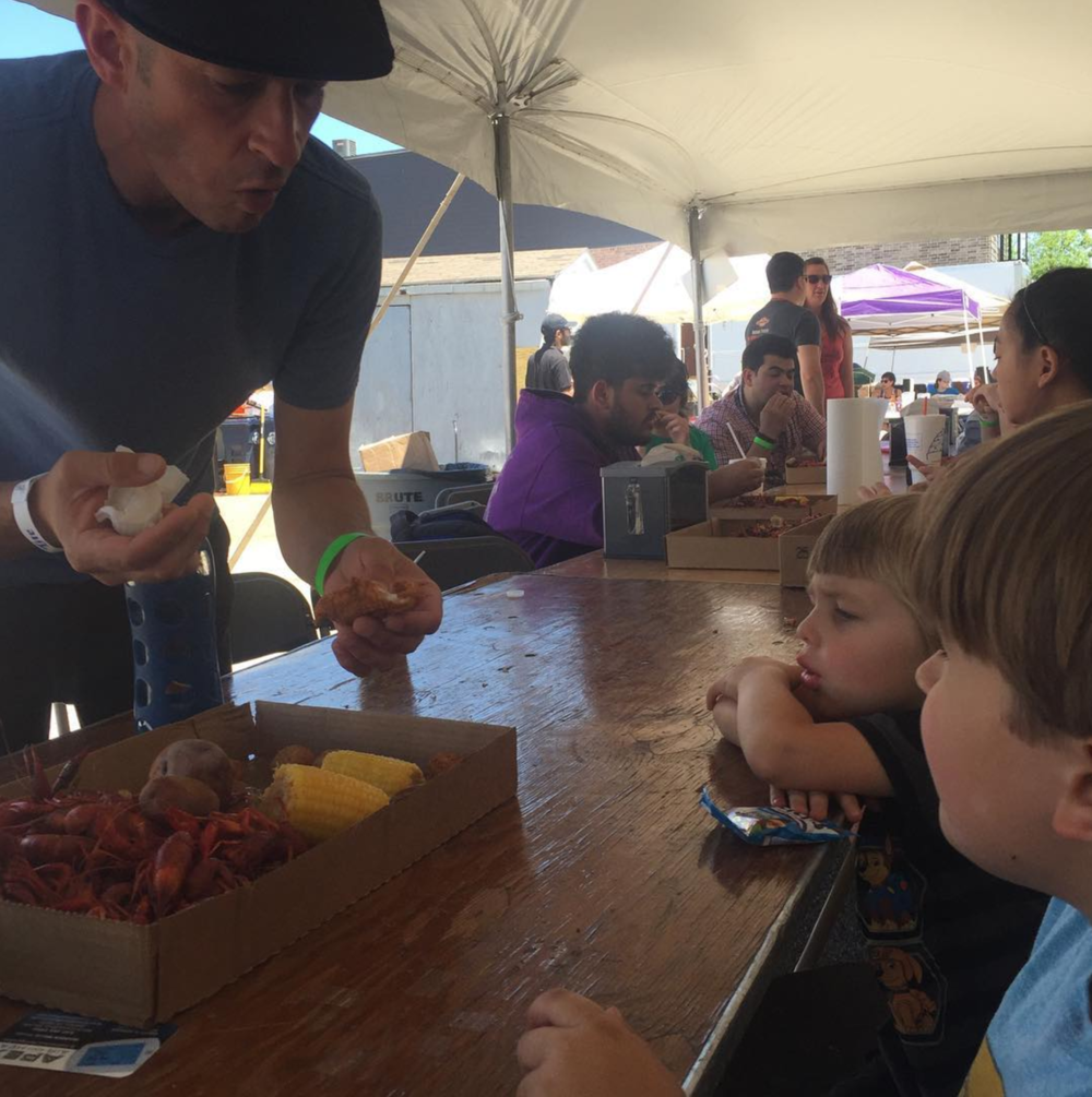 @kbrownies initiating young ones to the world of crawfish on Saturday's Mudbug Boil.