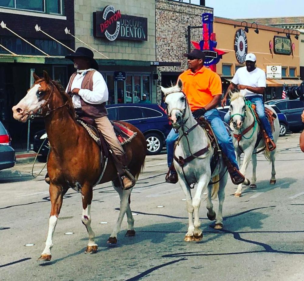 @dentonaut and some cowboys riding in the annual Juneteenth parade.