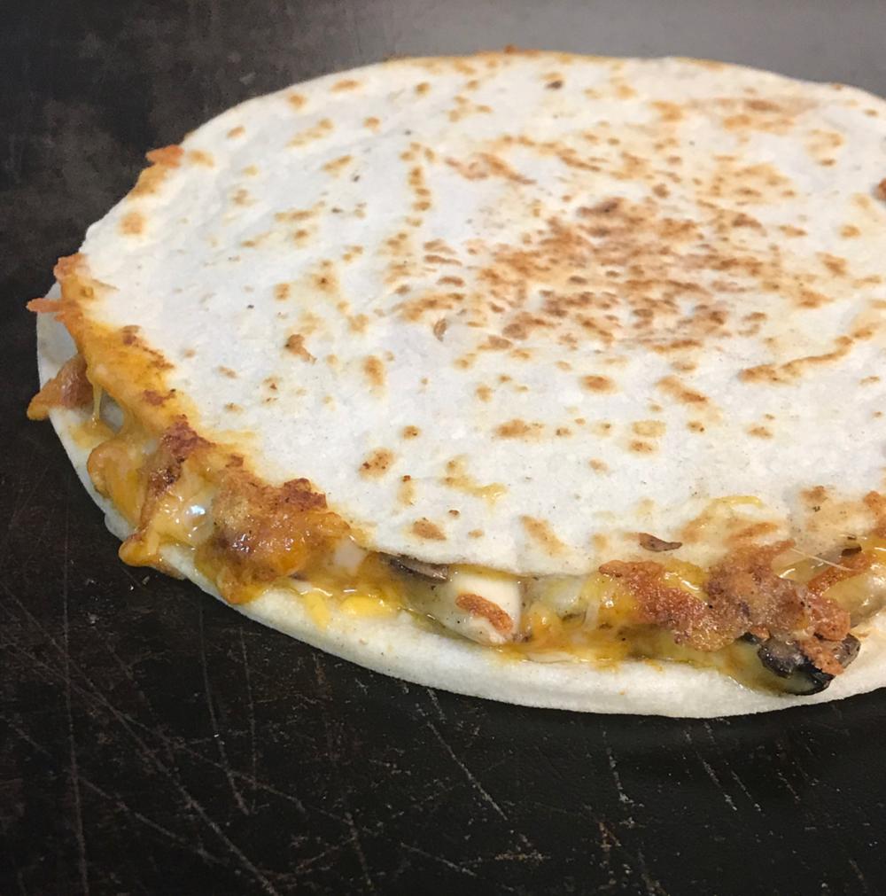 @el_taco_taxi's butter shroom quesadilla.