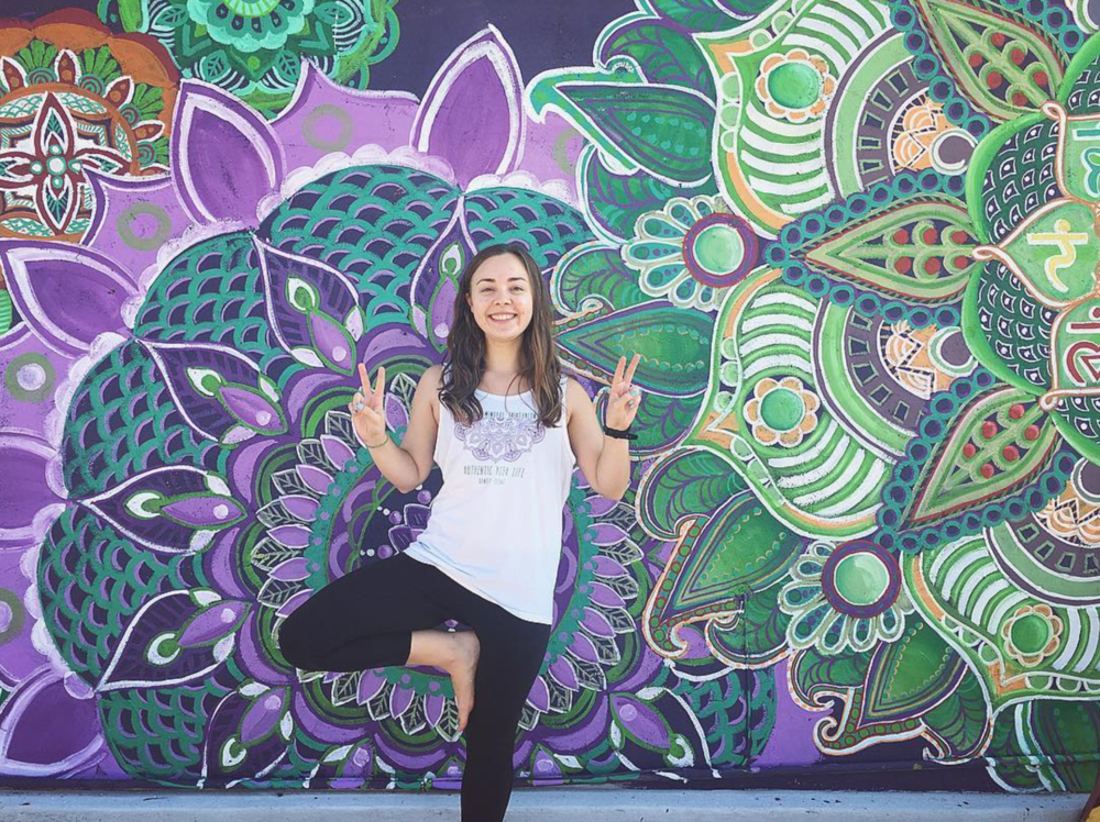 @authentic_liz in front of the new mural made by @erikakatht at Authentic Yoga Life.