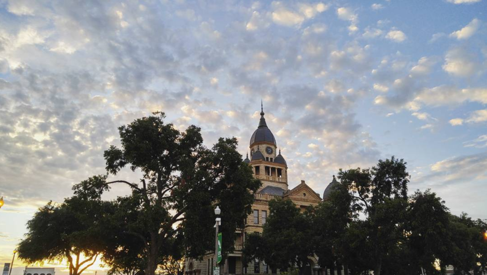 @big_b_1000 with a great shot of the courthouse in front of a cloudy sky.